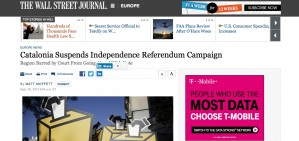 La policia espanyola empenyent joves amb urnes, al Wall Street Journal